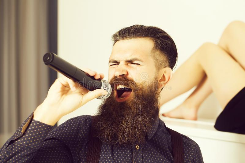 Bearded man singing and woman stock images