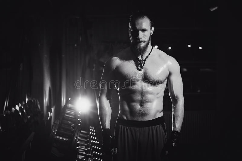 Young Handsome Brutal adult bodybuilder athletic hipster man with big muscles royalty free stock images