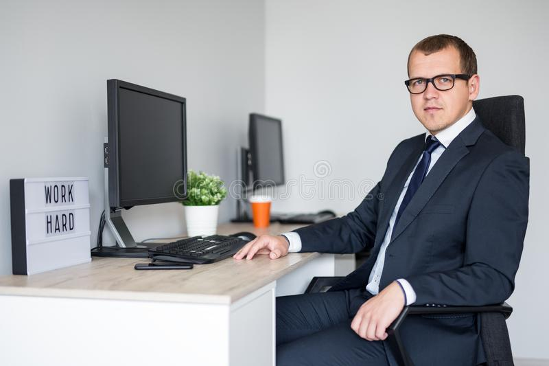 Young handsome business man in modern office royalty free stock images