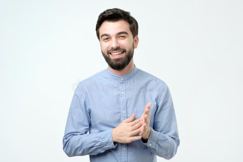 Young handsome business man with happy face smiling and looking at the camera. Young handsome business man over isolated background with happy face smiling and royalty free stock image