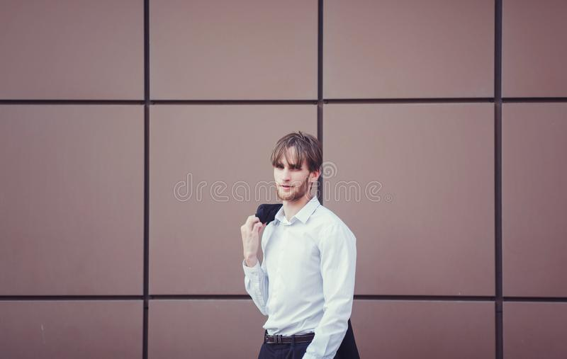 Young handsome businessman in the business center stock photo
