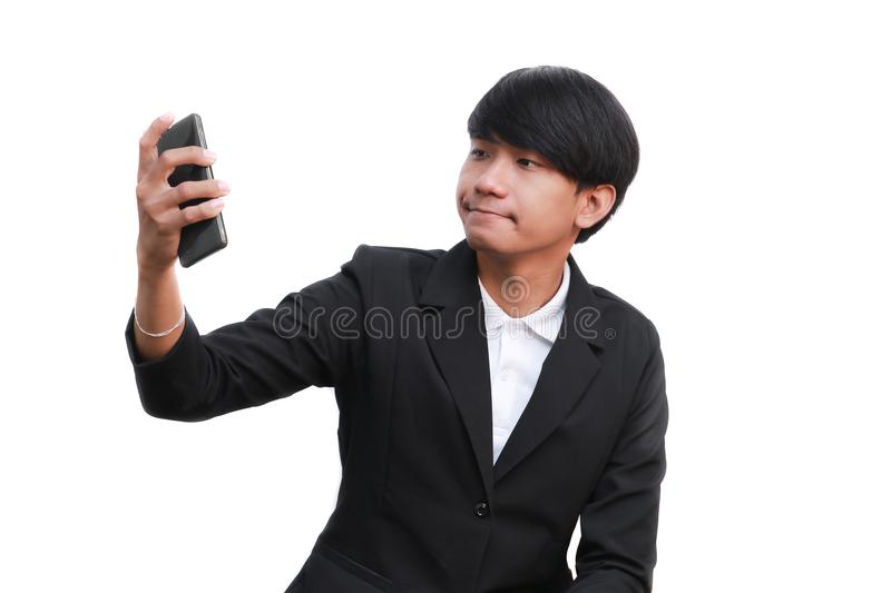 Young handsome businessman hold a phone call on white background royalty free stock photo