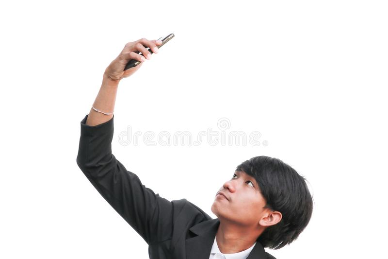 Young handsome businessman makes selfie on white background stock image