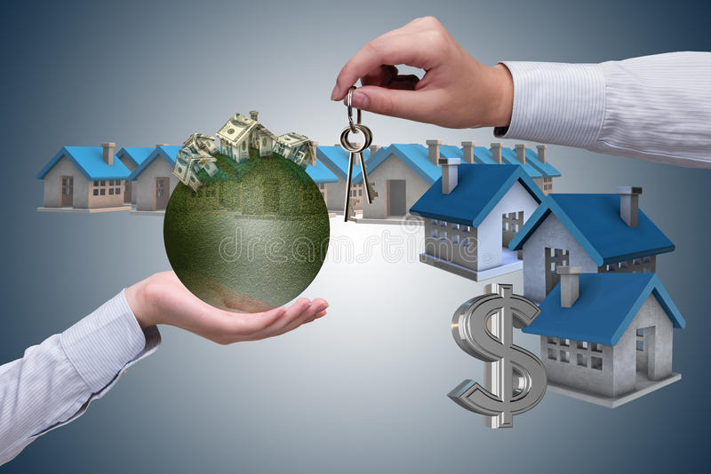 The young handsome businessman in mortgage concept. Young handsome businessman in mortgage concept stock photo