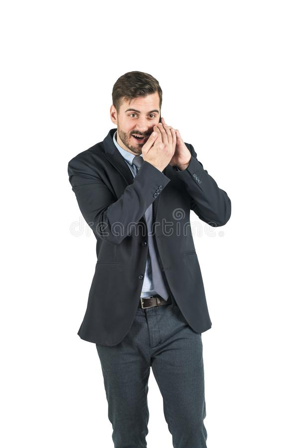 Young handsome businessman is on phone talk creating gossips. Isolated on white background. Concept of corporate secret stock images