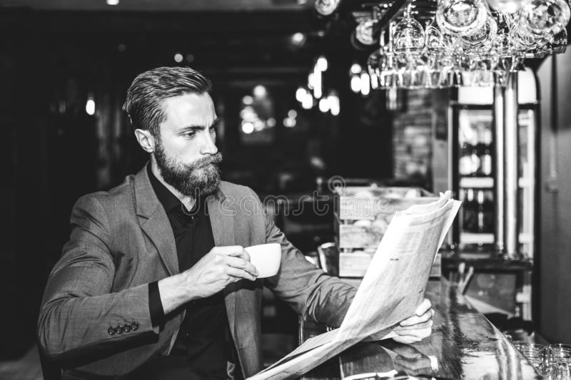 Young handsome businessman reading a newspaper royalty free stock photos
