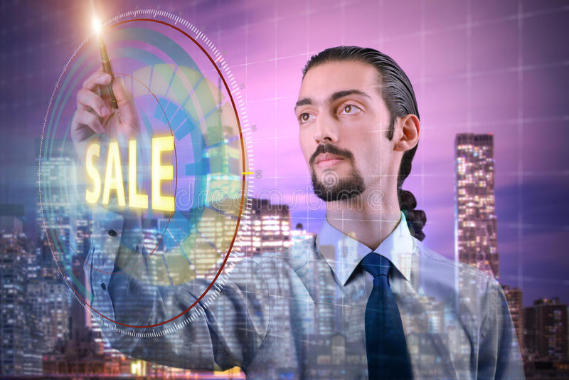The young handsome businessman in sales concept. Young handsome businessman in sales concept stock photo