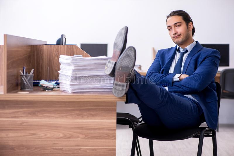Young handsome businessman working in the office. The young handsome businessman working in the office royalty free stock images