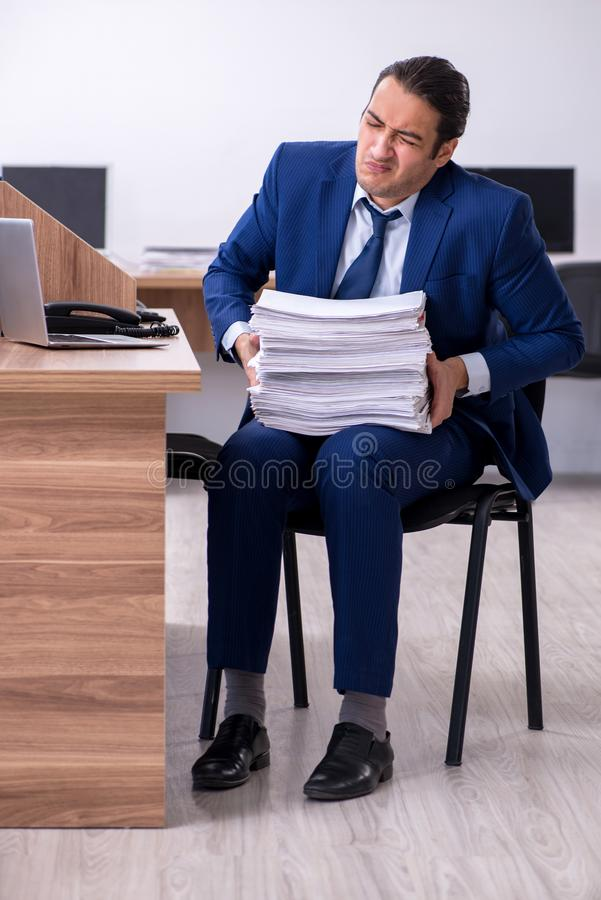Young handsome businessman working in the office. The young handsome businessman working in the office stock photos