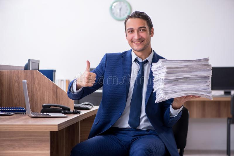 Young handsome businessman working in the office. The young handsome businessman working in the office royalty free stock photos