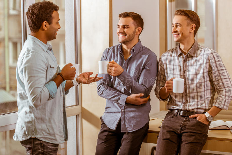 Young handsome businessmen coworking and resting stock photos