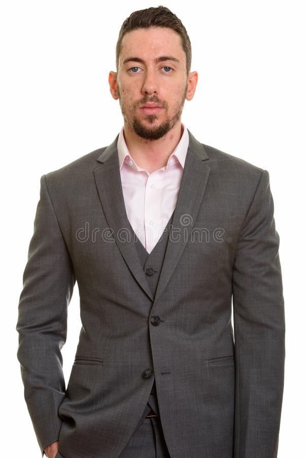 Young handsome Caucasian businessman looking at camera stock images