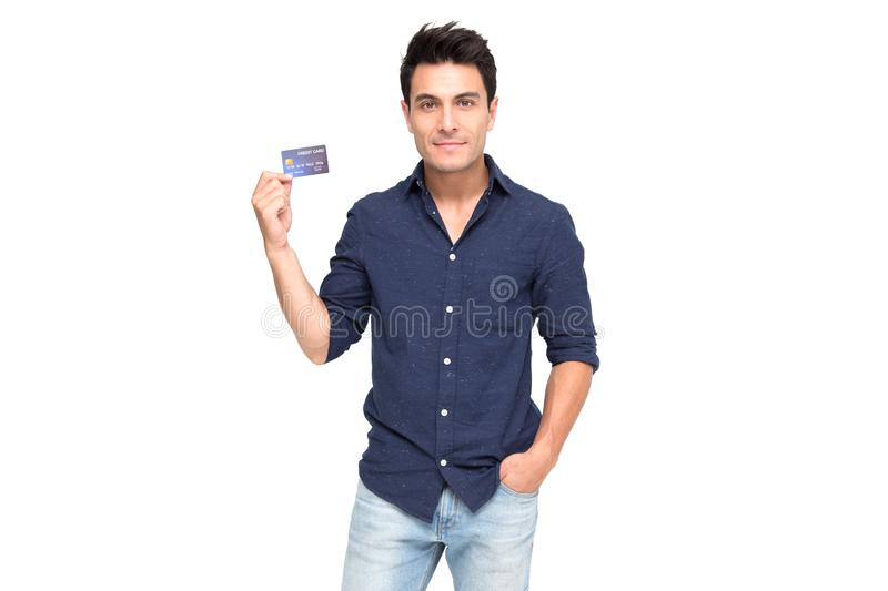 Young handsome Caucasian man smiling, showing, presenting credit card for making payment or paying online business, stock image