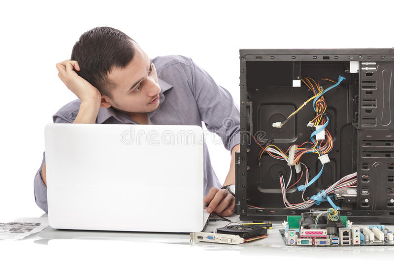 Young handsome computer specialist look confuse repairing computer. Portrait of young handsome computer specialist look confuse repairing computer stock image