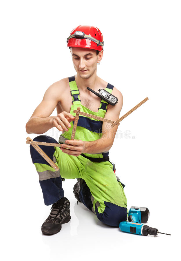 Young handsome contractor holding ruler on white royalty free stock image