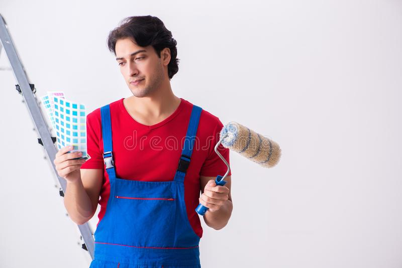 Young handsome contractor working indoors royalty free stock image
