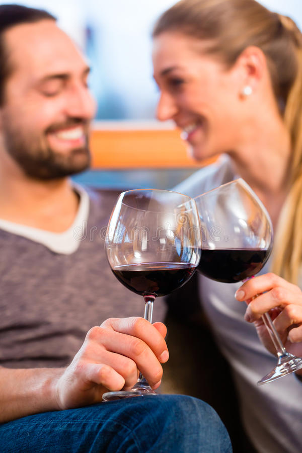 Young handsome couple drinking red wine royalty free stock photos