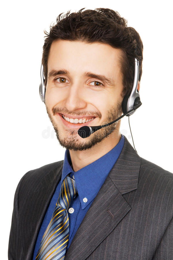 Young handsome customer service operator. Isolated on white background stock image