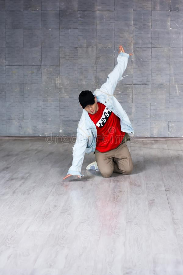 Young handsome dancer on floor. royalty free stock photo