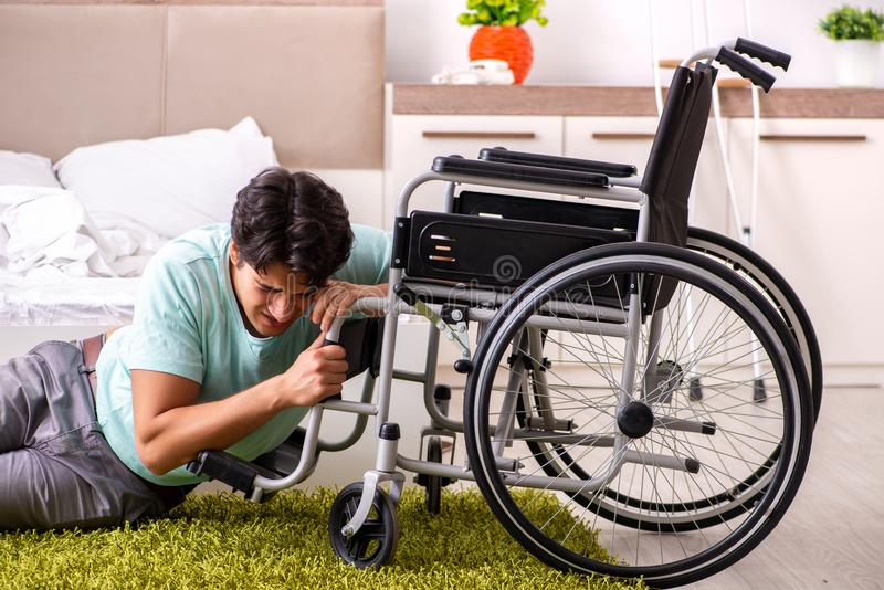 The young handsome disabled man recovering at home. Young handsome disabled man recovering at home royalty free stock image