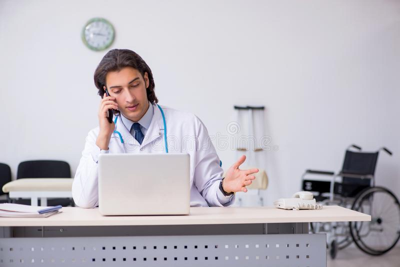Young handsome doctor in telemedicine concept. The young handsome doctor in telemedicine concept royalty free stock images