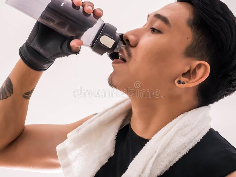 Young handsome drink water after exercise stock images