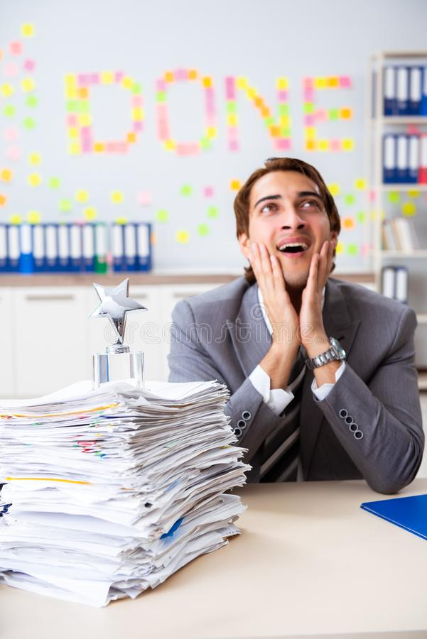 The young handsome employee sitting at the office. Young handsome employee sitting at the office royalty free stock photos