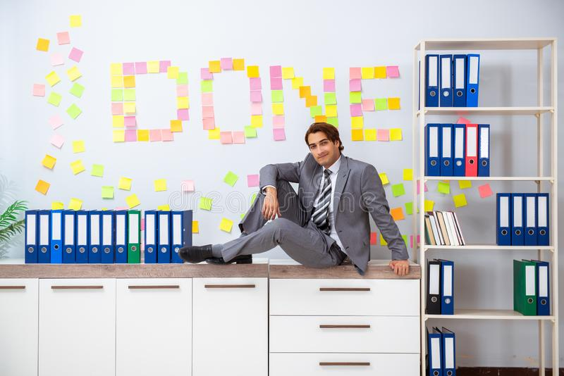 The young handsome employee sitting at the office. Young handsome employee sitting at the office royalty free stock photo