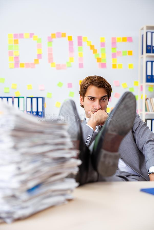 The young handsome employee sitting at the office. Young handsome employee sitting at the office stock images