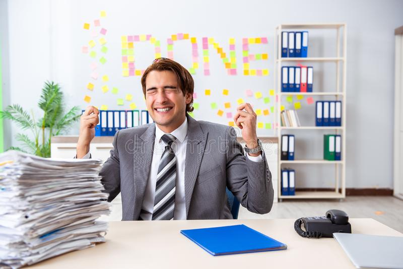The young handsome employee sitting at the office. Young handsome employee sitting at the office stock photography