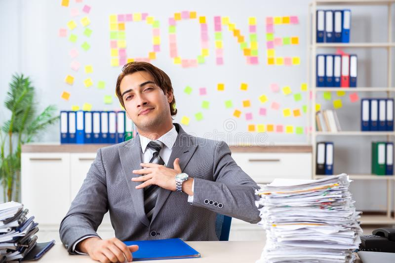 The young handsome employee sitting at the office. Young handsome employee sitting at the office royalty free stock images