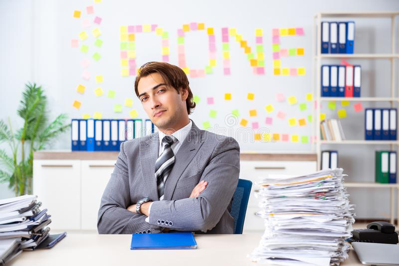 The young handsome employee sitting at the office. Young handsome employee sitting at the office stock photo