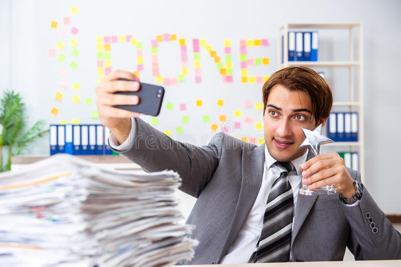 The young handsome employee sitting at the office. Young handsome employee sitting at the office stock photos