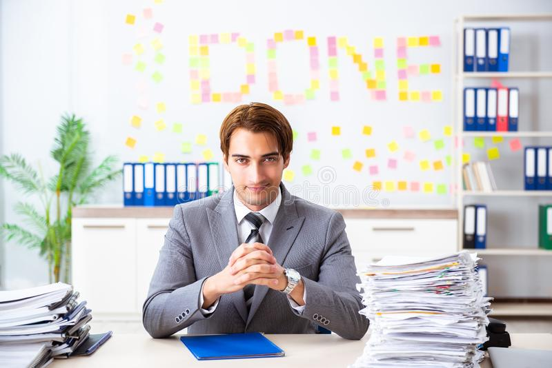 The young handsome employee sitting at the office. Young handsome employee sitting at the office royalty free stock photography