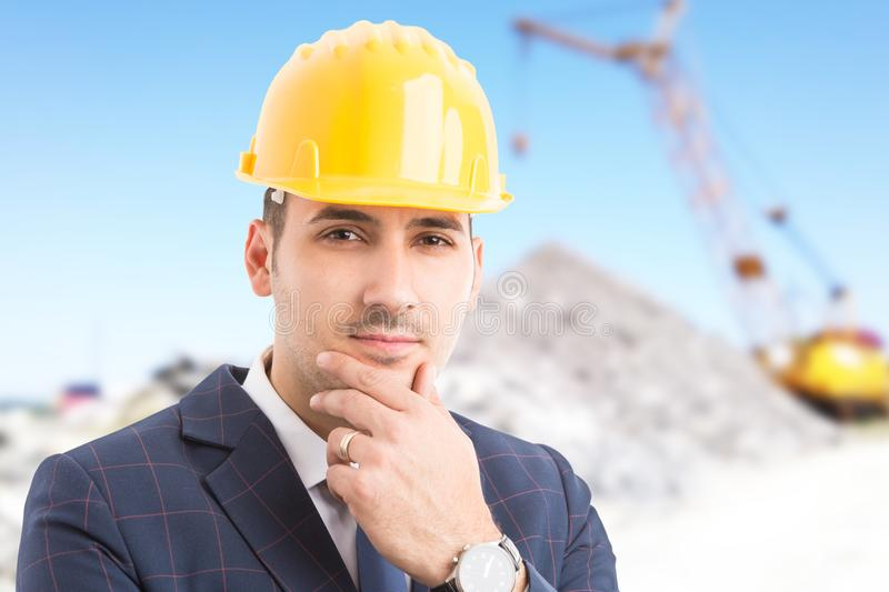 Young handsome engineer on construction site stock image