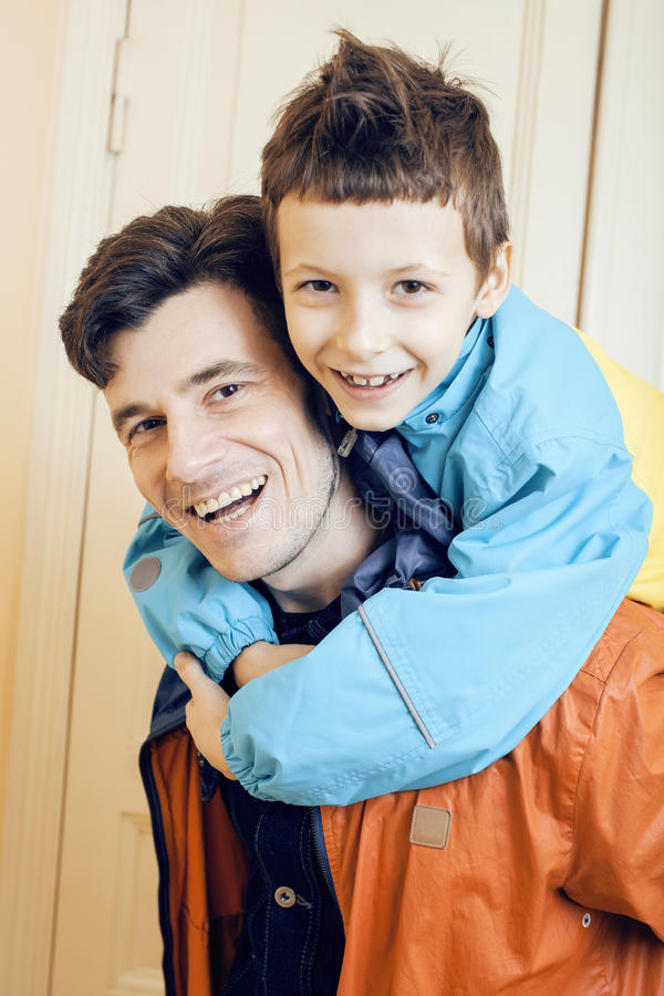 Young handsome father with his son fooling around at home, lifestyle people concept. Close up stock images