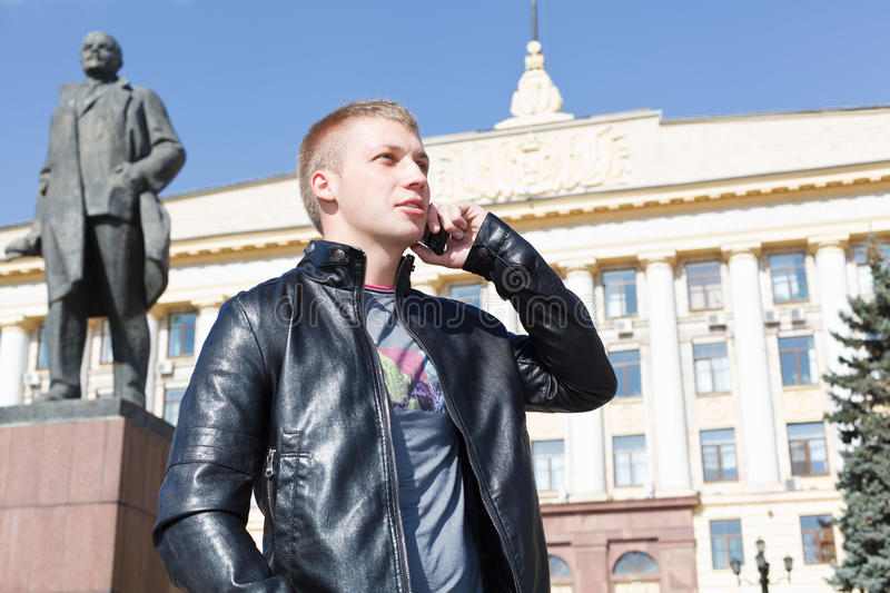 Young handsome guy calling by mobile phone stock photography