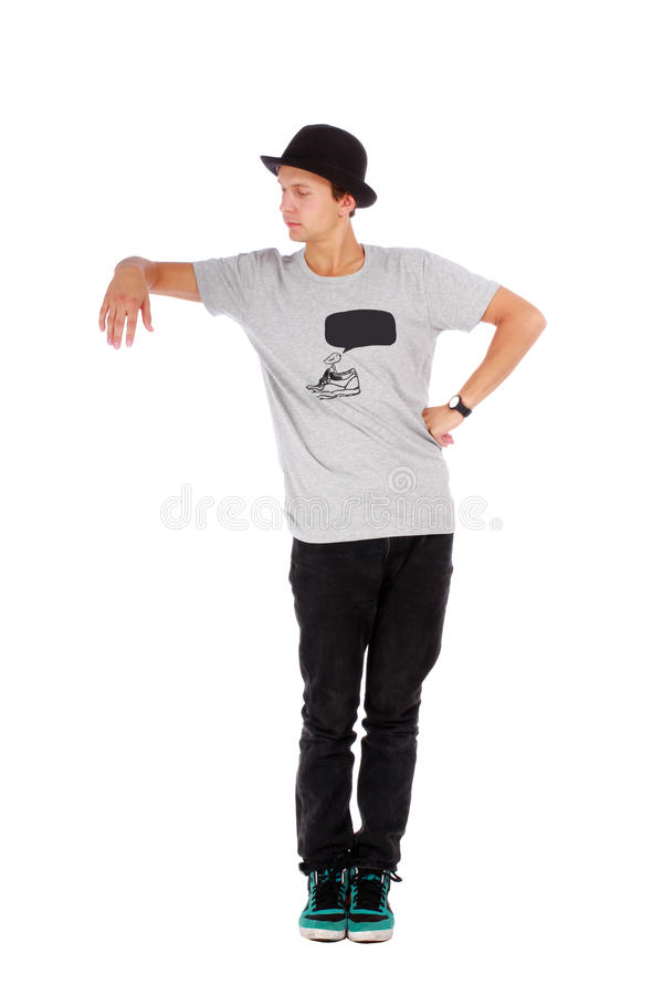 Young handsome guy with a modern clothes and a hat. On white background stock images