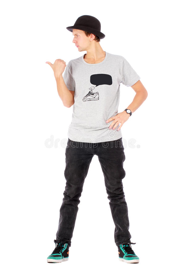 Young handsome guy showing with thumb to the left. On white background stock photos