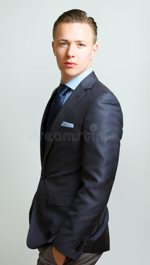 Young Handsome Guy Looking Sidewards At Camera Royalty Free Stock Image