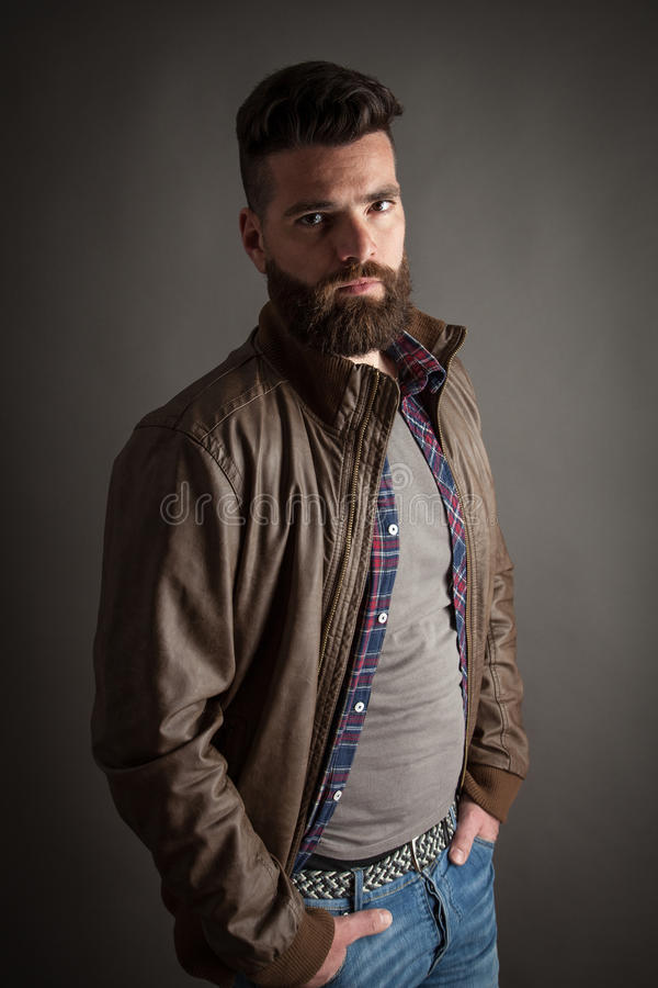 Young handsome hipster with beard stock images