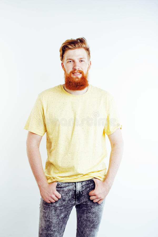 Young handsome hipster bearded guy looking brutal isolated on white background, lifestyle people concept. Close up stock photo