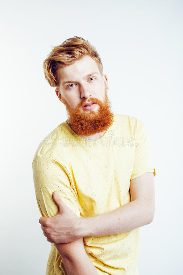 Young handsome hipster bearded guy looking brutal isolated on white background, lifestyle people concept. Close up stock photography