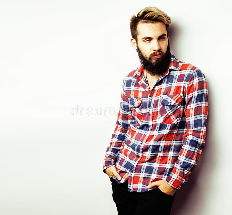 Young handsome hipster bearded guy looking brutal isolated on white background, lifestyle people concept. Copyspace stock photo