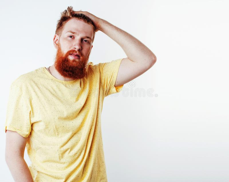 Young handsome hipster ginger bearded guy looking brutal isolate. D on white background, lifestyle people concept close up royalty free stock photography
