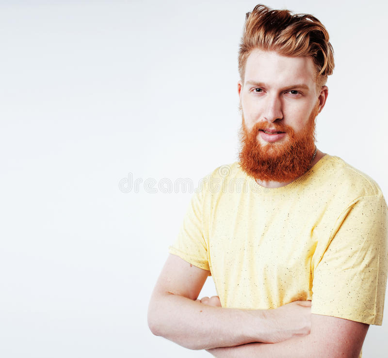Young handsome hipster ginger bearded guy looking brutal isolated on white background, lifestyle people concept. Close up stock photography