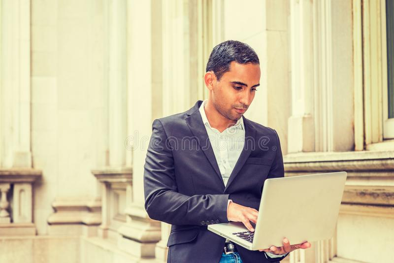 Young Handsome Hispanic American college student studying in New royalty free stock photo