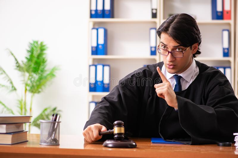 The young handsome judge working in court. Young handsome judge working in court stock photography
