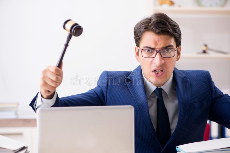 The young handsome judge working in court. Young handsome judge working in court royalty free stock photo