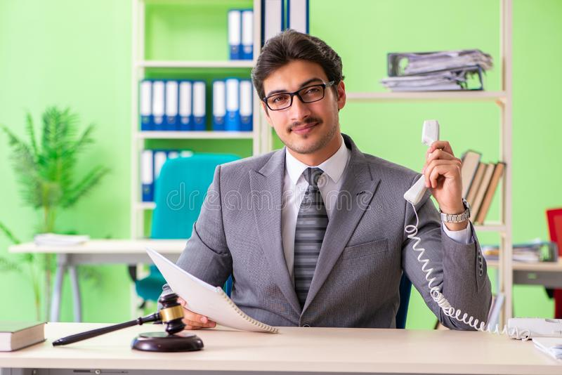 The young handsome lawyer working in the office. Young handsome lawyer working in the office stock photo